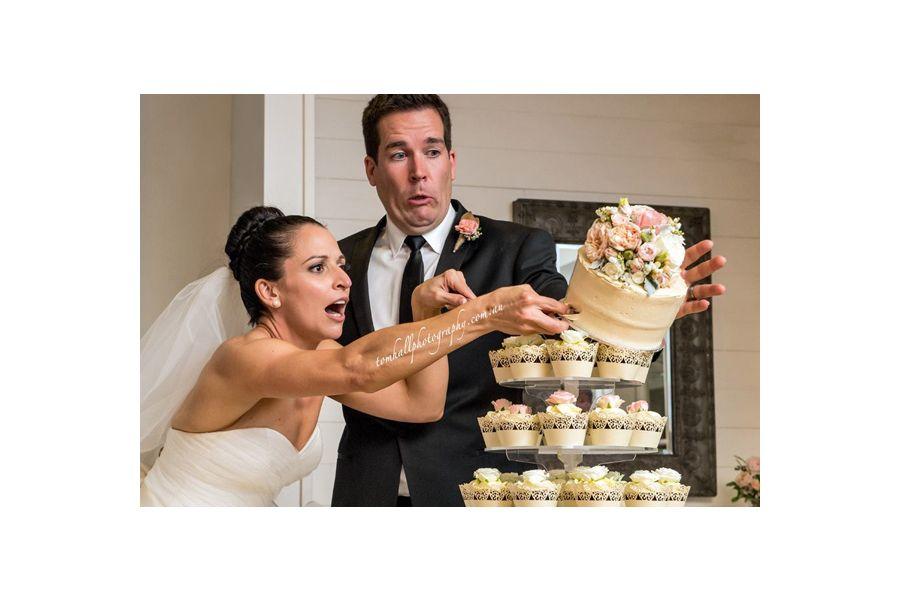 Charleston SC Brides Couple Topples Over Wedding Cake